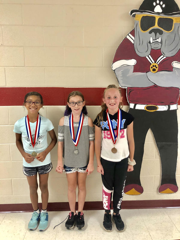 ELEMENTARY STUDENTS RECEIVE MILE CLUB MEDALS